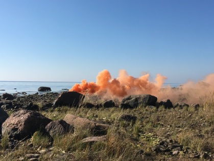 Orange smoke bomb Reposaari